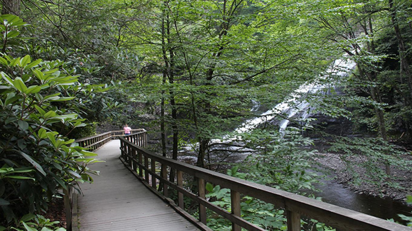 The elevated boardwalk at Dingmans provides a shady trail to the waterfalls that is wheelchair accessible. – National Park Service