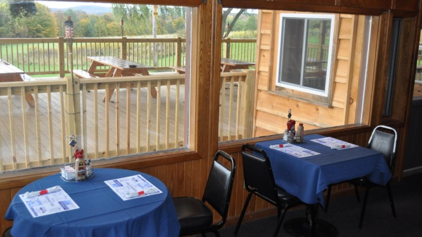 Dining room looking to outdoor dining pavilion