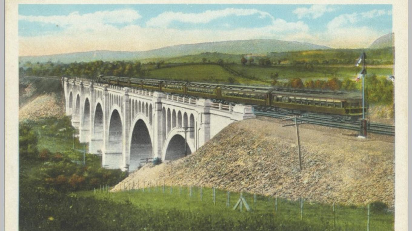 DL&W Hainesburg / Paulinskill Viaduct. It crosses the Paulinskill river just East of the Delaware River on the Lackawanna (NJ) Cutoff. It has 7 arches and is 1100 feet long and 115 feet high. – Antique postcards believed to be at least 80 years old.