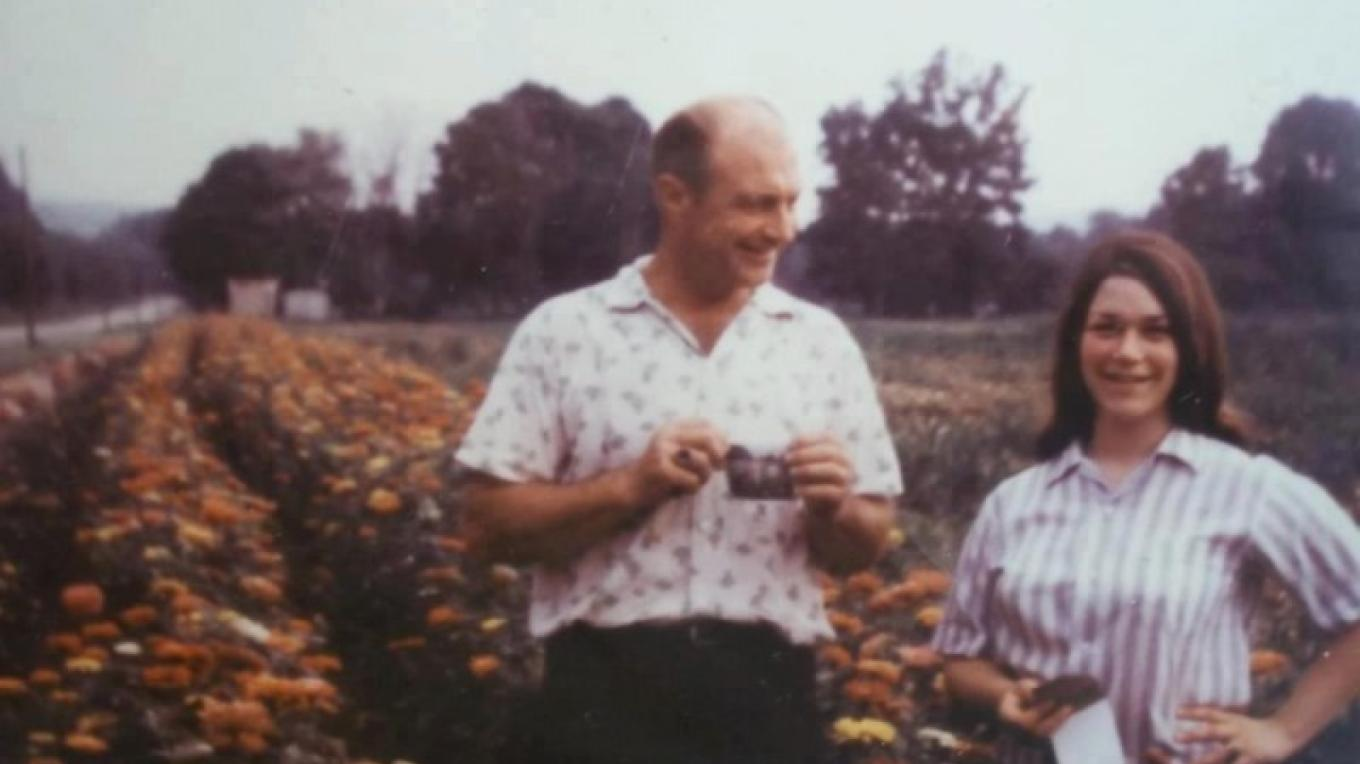 George Marshall and Marianne Marshall (Saponaro) standing in a field of zinnias, 1969. – Photograph by: Marshall's' Farm Market and Country Store