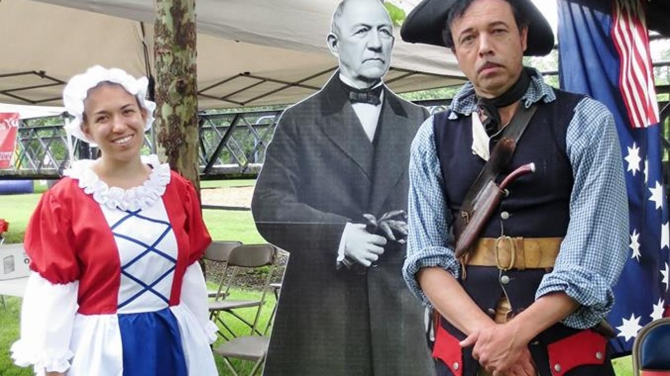Alyssa Lidman and Andy Drysdale, curator of Warren County Cultural and Heritage Commission, pose with John I. Blair. July Fourth festivities held at Footbridge Park – Cynthia Montes