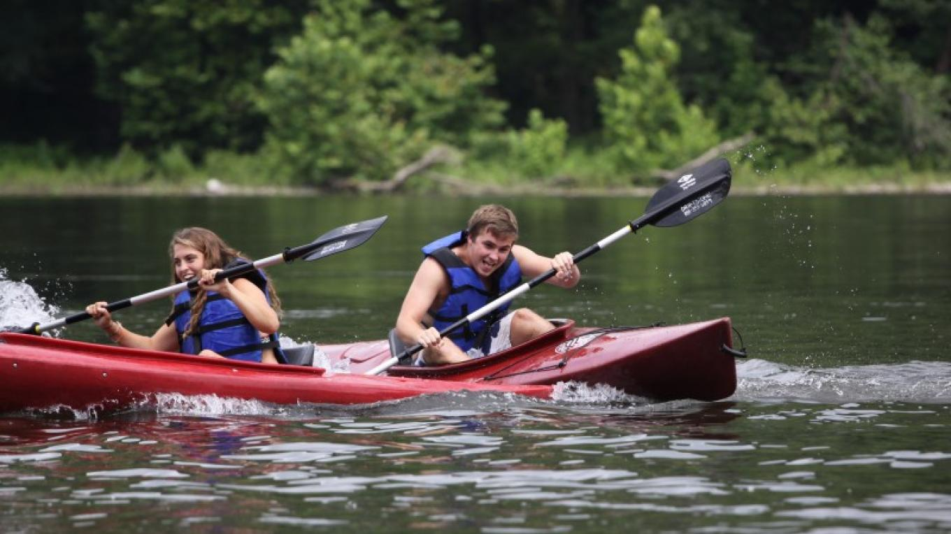 Kayak race on the Delaware River. – Photograph by: Driftstone Campground