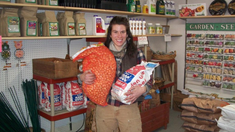 Aline holding Seed potatoes & Onion Sets – Aline Haddad & Jesse Poliskiewicz
