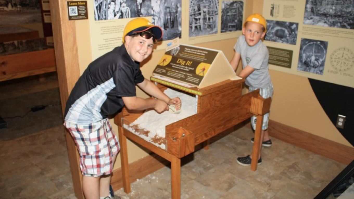 """Kids digging a tunnel in the exhibition, """"Tunnel, Toil and Trouble: New York City's Quest for Water and the Rondout-Neversink Story"""" – Dennis Muthig"""