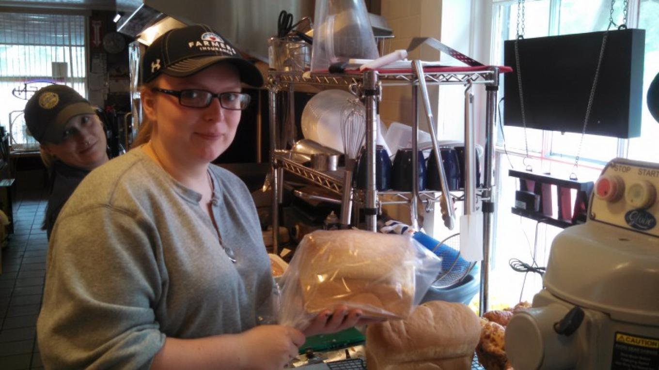Emalee bagging up the fresh homemade bread she just made