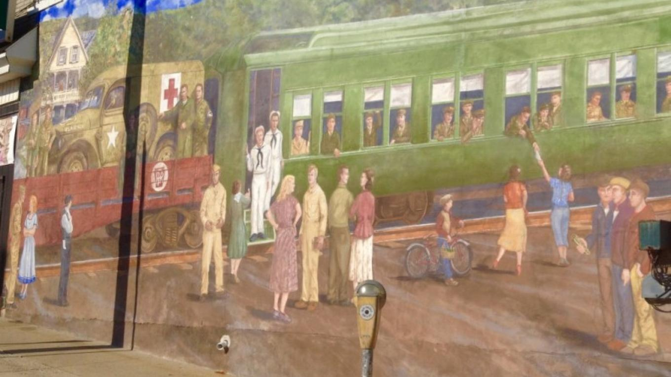 """Homefront"" Heritage Mural at main intersection, So. Robinson and Pennsylvania Ave (Rt. 512), in Pen Argyl. Heritage Murals are ongoing and can be viewed in Bangor, Pen Argyl and Wind Gap. – Property of the Slate Belt Community Partnership"