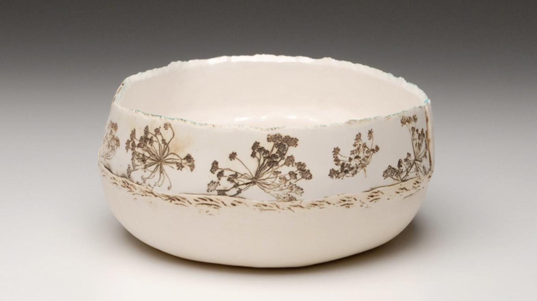 White stoneware bowl with nature imprint – Photograph by: Dana Duke
