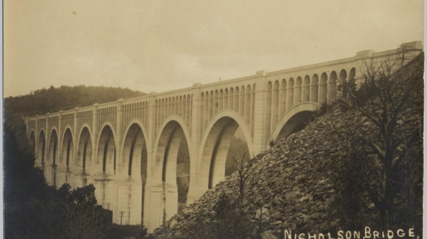 DL&W Tunkhannock Creek Viaduct spans the Tunkhannock Creek in Nicholson, PA. Measuring 2,375 ft long and 240 ft above the creek bed; 300 ft from bedrock. Completed in 1915 as the largest concrete bridge in America. – Antique postcards believed to be at least 80 years old.