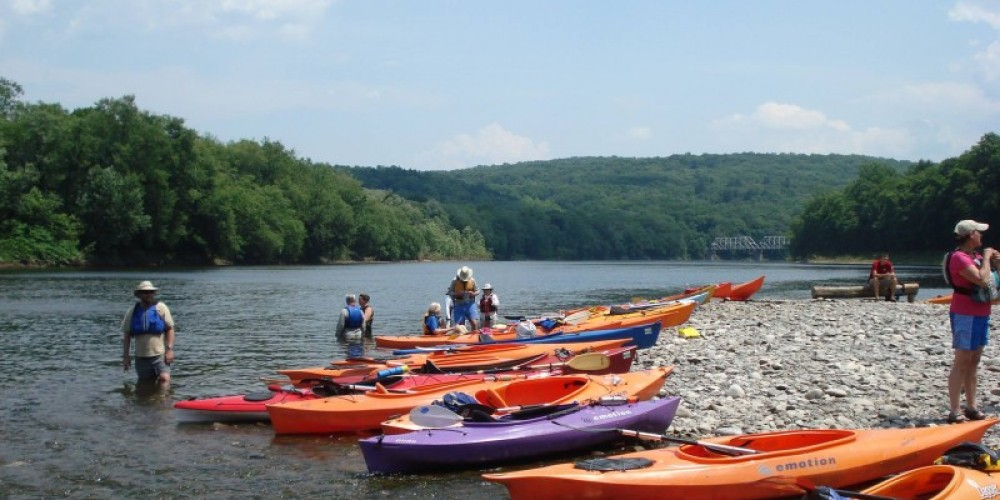 Sojourners stop for a break just north of the Dingmans Ferry Bridge on the 2013 Delaware River Sojourn. – Kate Schmidt, Delaware River Basin Commission