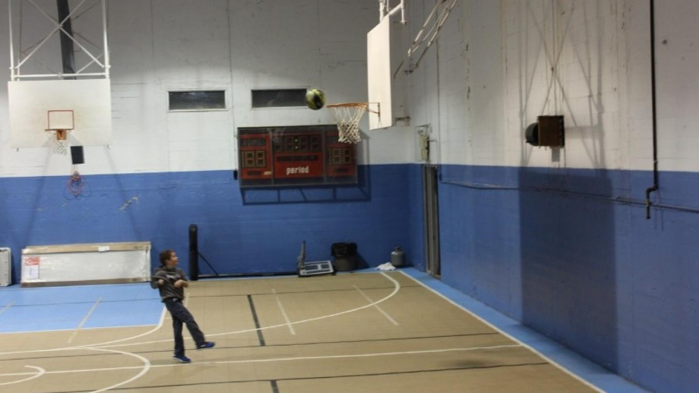 Portland gymnasium-Looking at the basketball court from the stage – Yvonne Gumaer/Heather Fischer