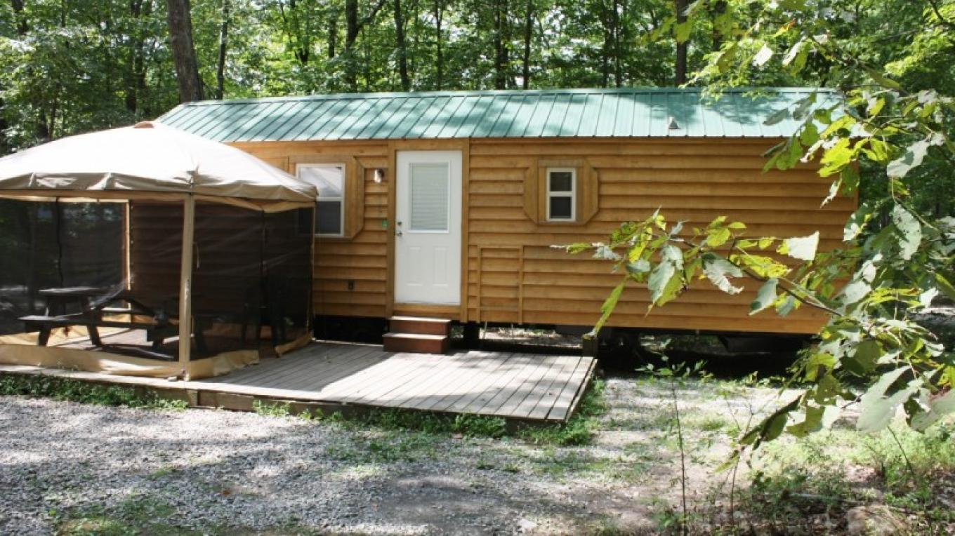 Deluxe cabins with kitchens and showers. – Camp Taylor Campground