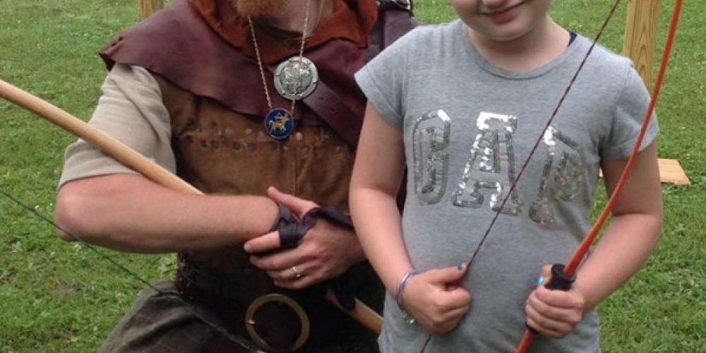 Young shooter at Krebashia Kingdom Renaissance Fair in Malone, N.Y.