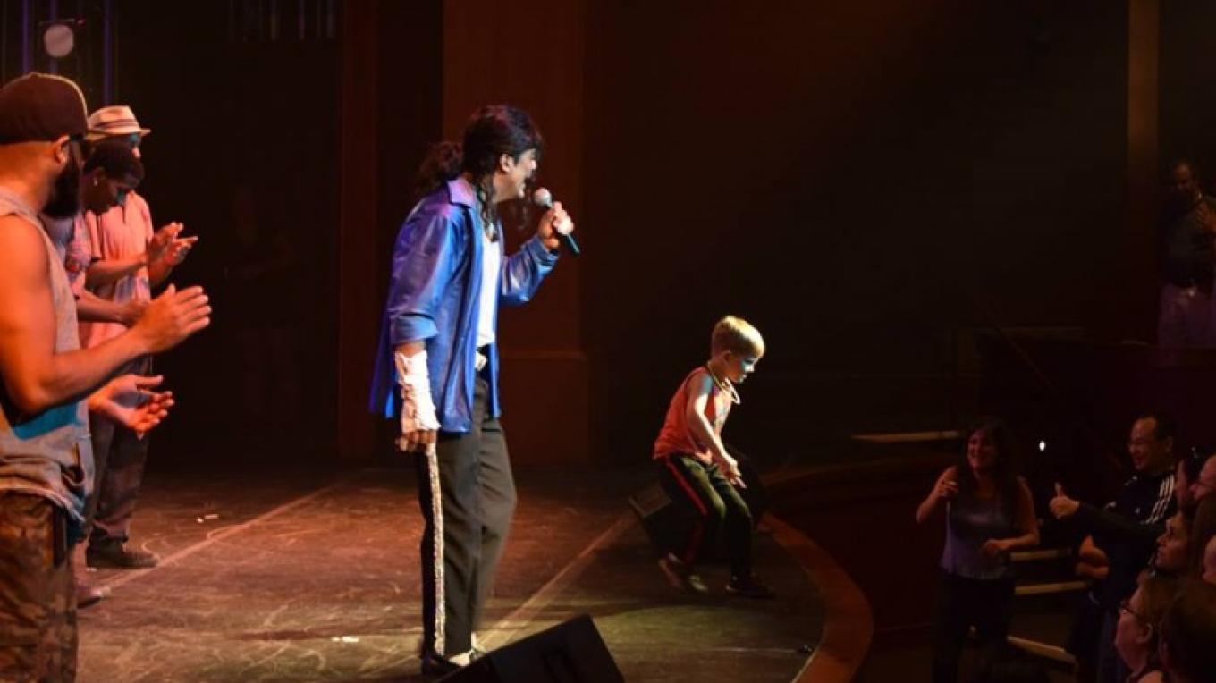 """Audience participation welcome! A talented young dancer joins Joby Rogers onstage during """"The Ultimate Michael Jackson Experience."""""""