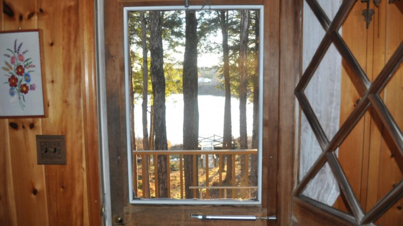 View from front door of lakefront chalet to dock and lake