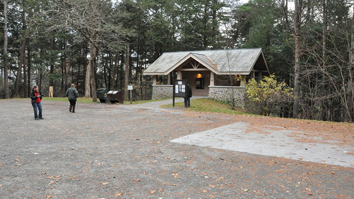 View of the Raymondskill Creek Trail parking lot and restrooms. – National Park Service