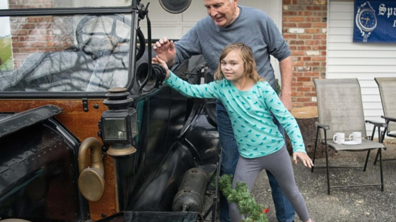 Visitor tries out the horn of antique Model T Ford. – Nancy Madacsi