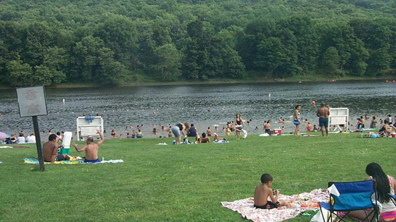 Go swimming in the Delaware River at one of our three designated swim beaches. – National Park Service