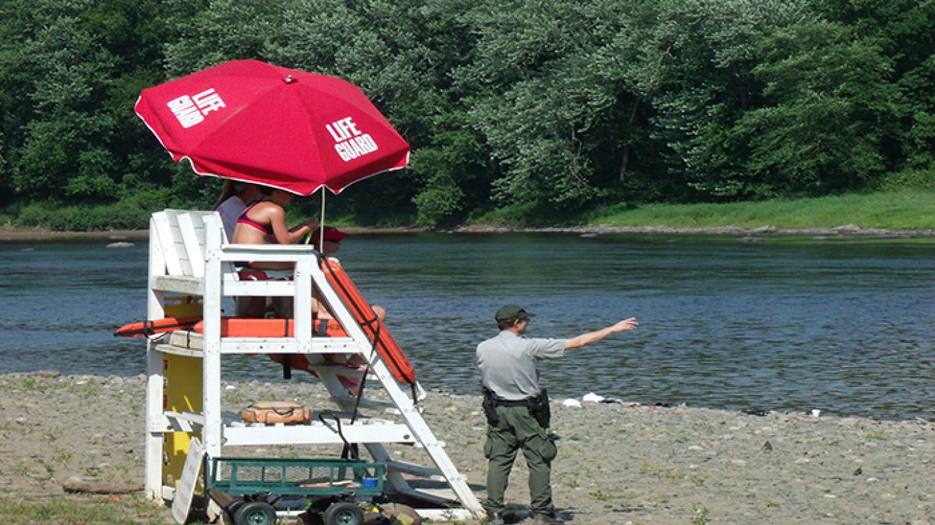 Lifeguards and rangers keeping watch at Milford Beach. – National Park Service