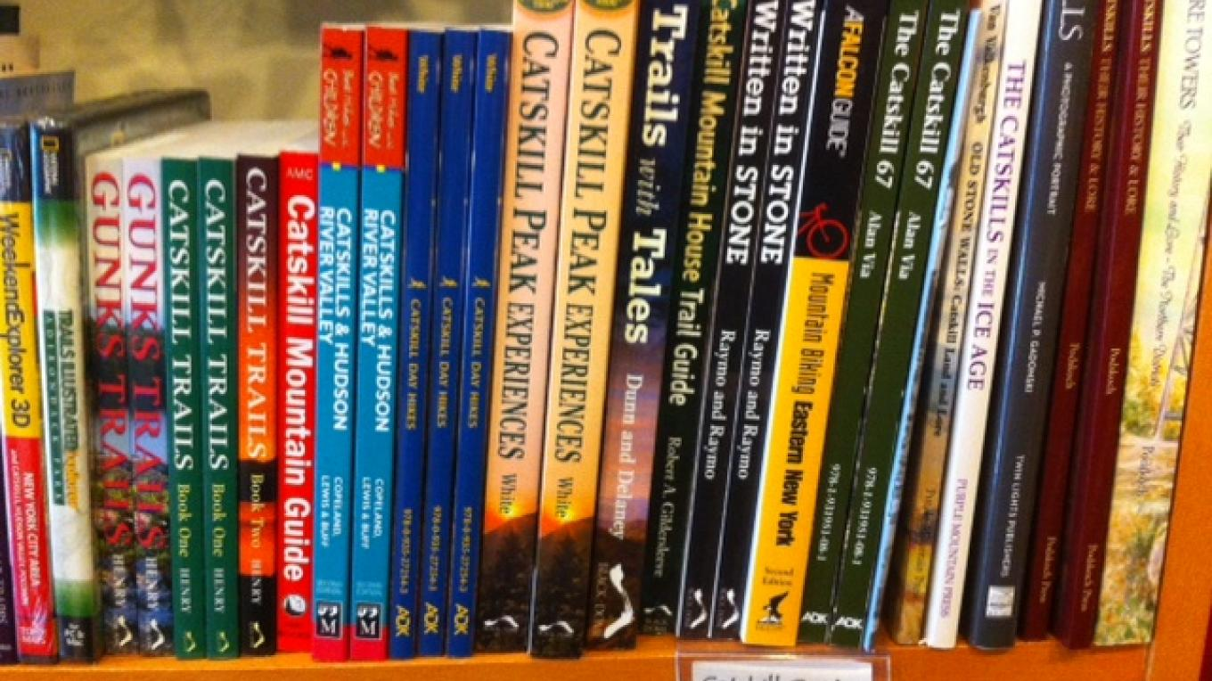 Our bookshelves are filled with great books, including local authors and guidebooks. – L. M. Lyons