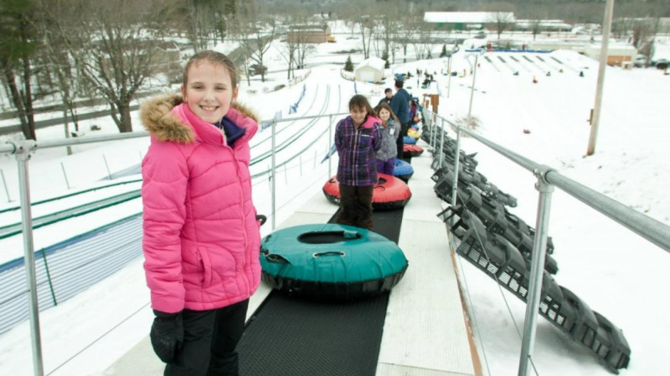 Ride the Magic Carpet lift up and slide down at White Lightning Snowtubing located next to The Villas at Fernwood Resort in Bushkill, PA. – David Coulter