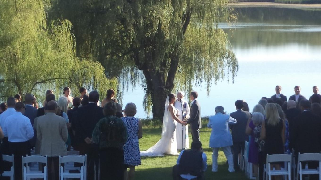 Wedding ceremony on the back lawn overlooking the Allamuchy Pond – Laurie Rapisardi