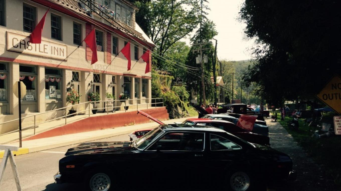 Front of Main Building with Annual Car Show – Photograph by: Castle Inn