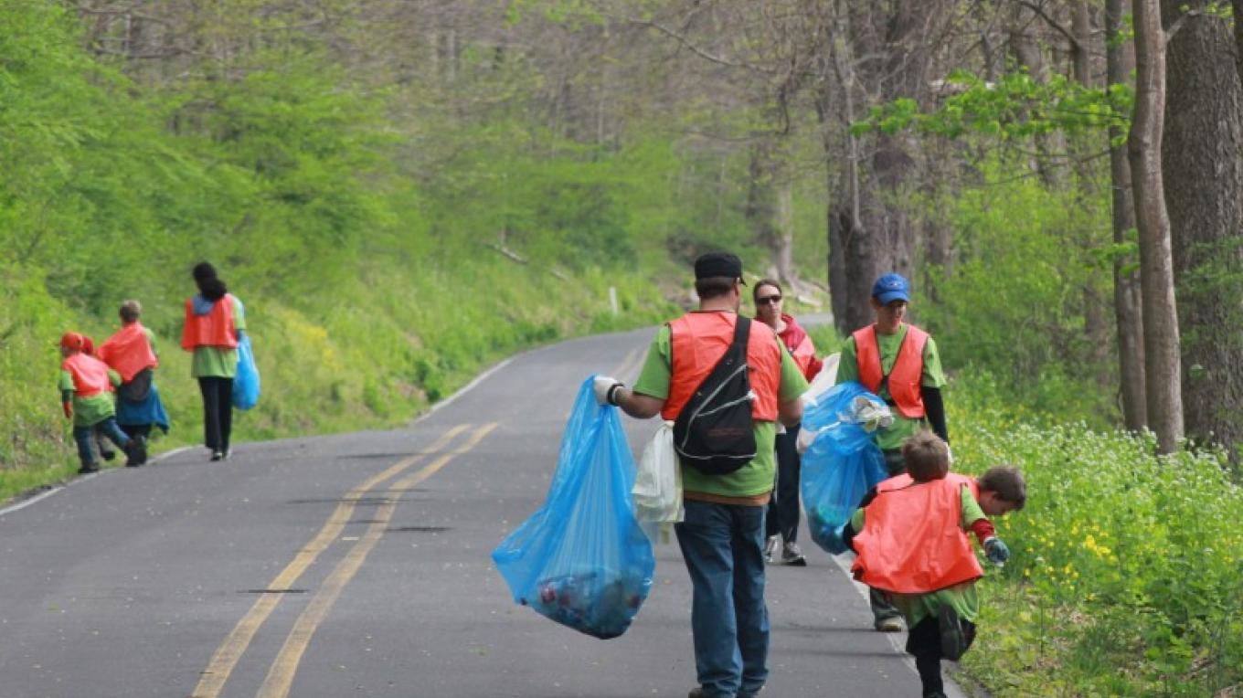 Encouraging volunteerism in our Parks. Pictured: Volunteers participate in park cleanup. – National Park Service