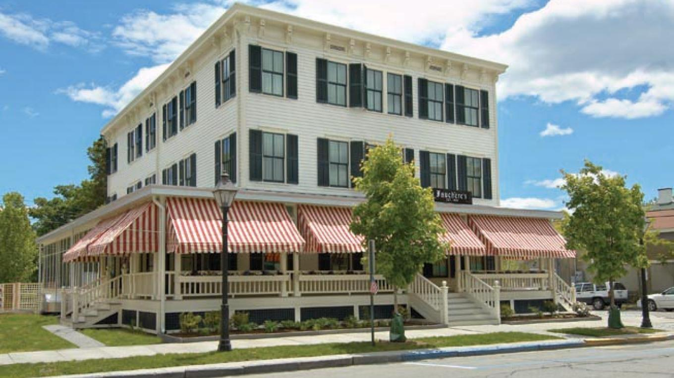 The hotel's bright red and white striped awnings are a familiar and welcoming site.