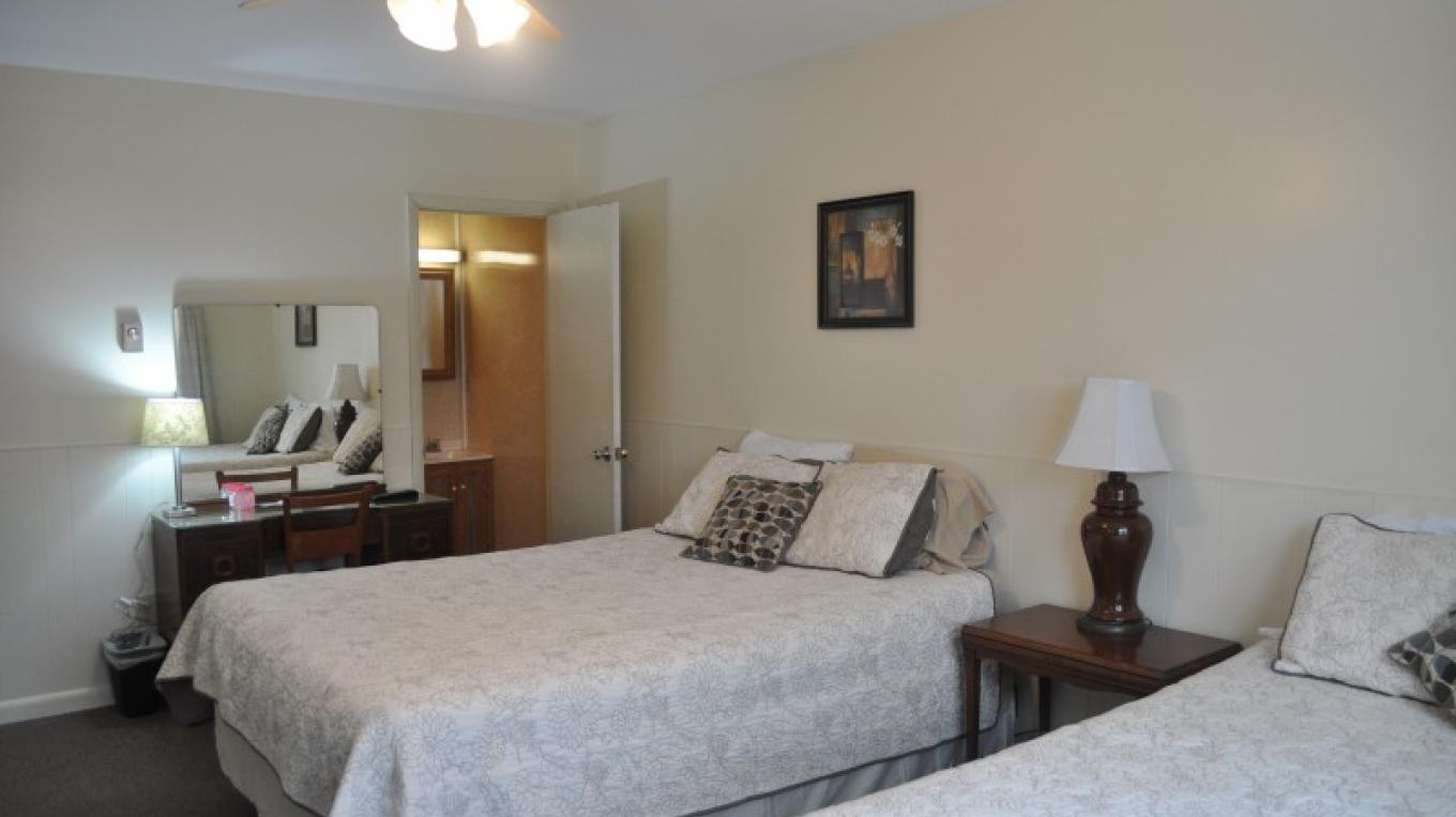 Standard 2 queen bedroom with private entrance and private bath; pet dog friendly; joins adjacent room to form a 3 queen bed suite with 2 private baths. Has HDTV with cable service and free WiFi.