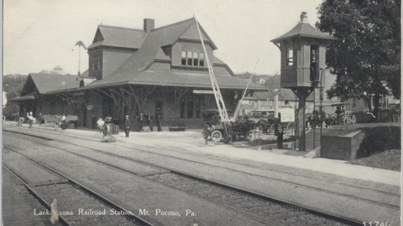 DL&W Station at Mt. Pocono, PA. The tower at the right is the crossing guard's tower. He would climb down to lower the gates when a train approached. – Antique postcards believed to be at least 80 years old.