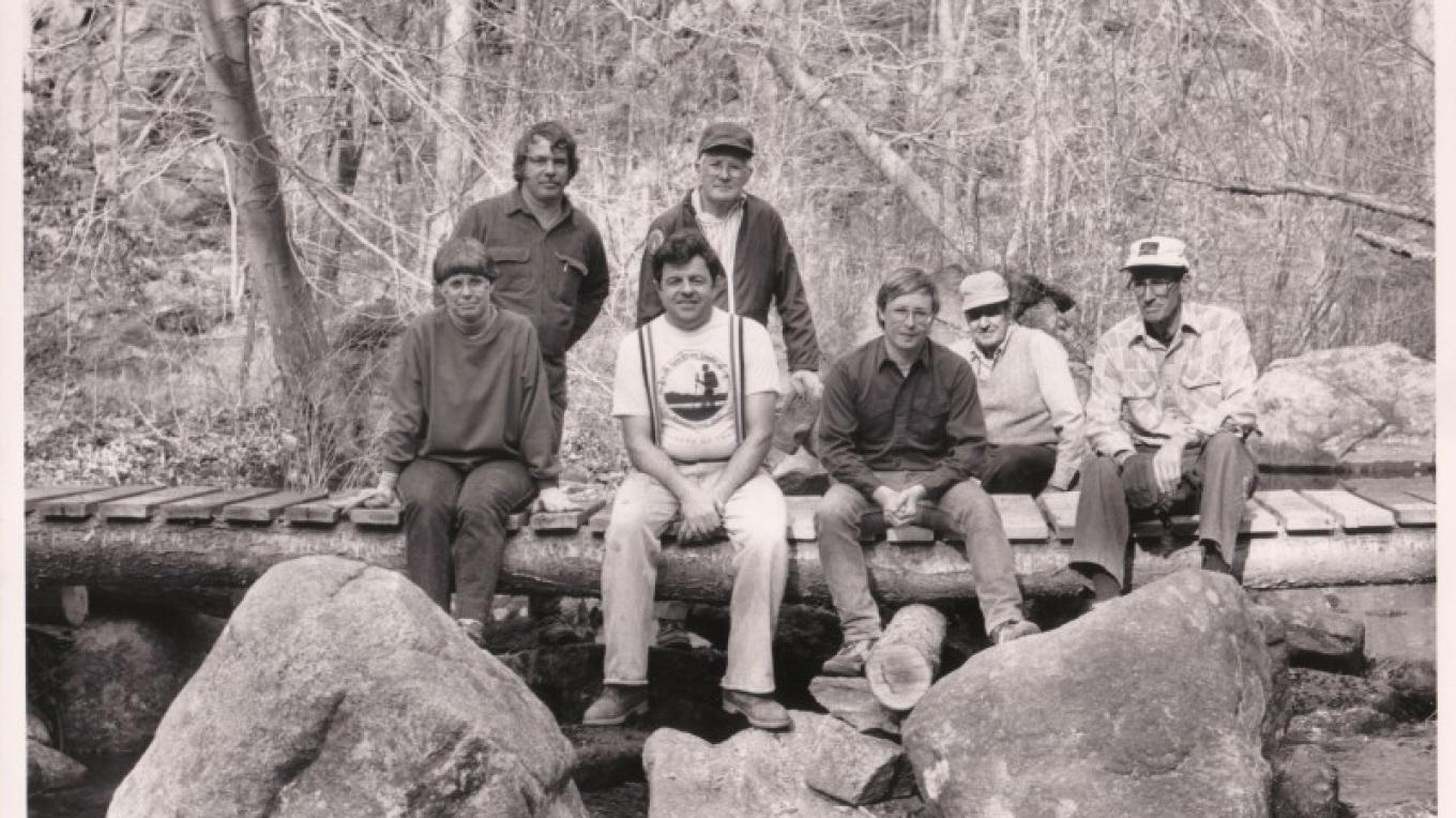 A historic photo of Trail Conference volunteers taking a break from work. – New York-New Jersey Trail Conference