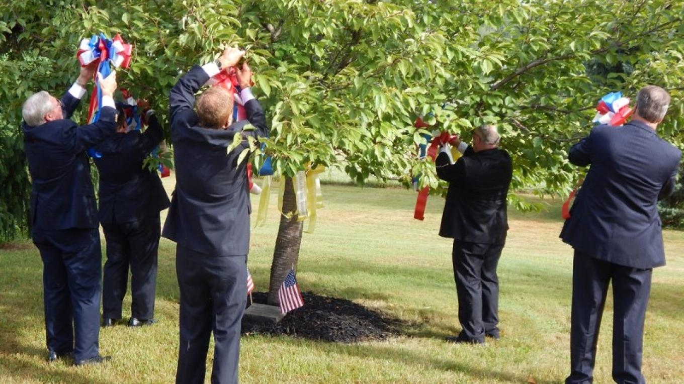 911 Ceremony - Dignitaries pinning memorial ribbons in honor of victims – Norma Schadt