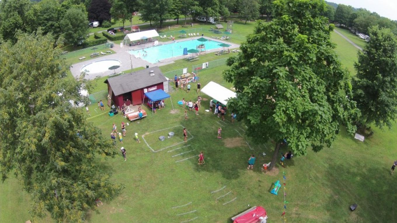 Ariel view of the Driftstone pool and pool field where many activities take place such as the Annual Carnival. – Photograph by: Driftstone Campground