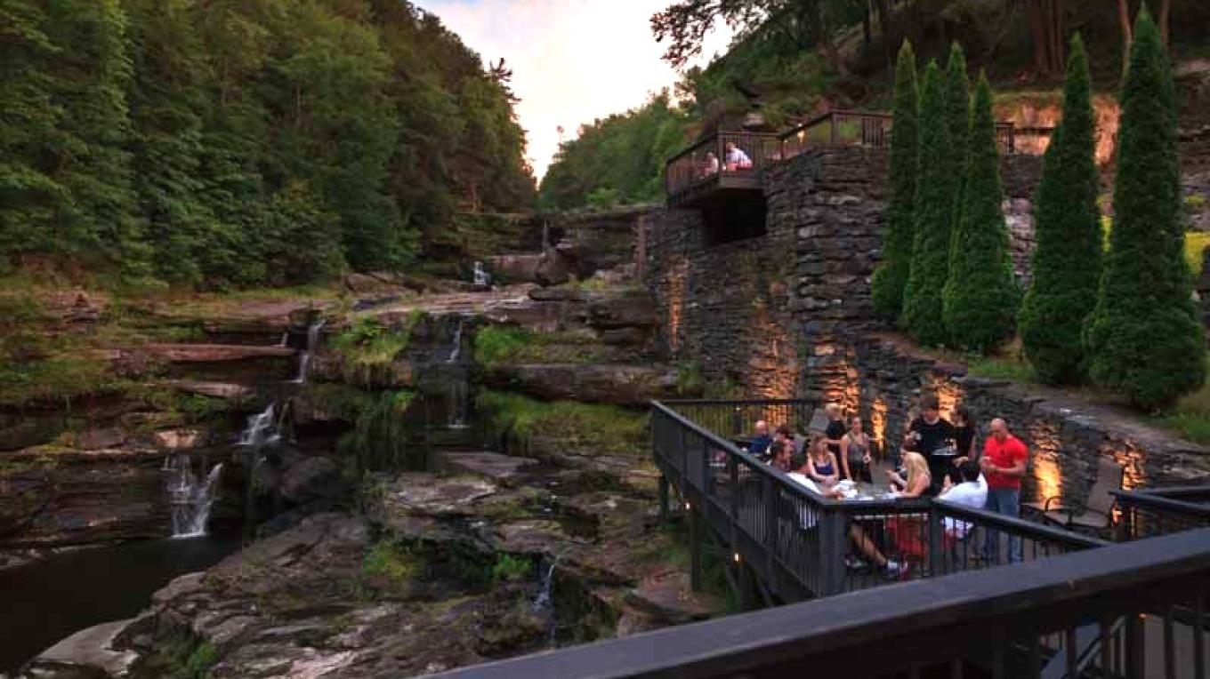 "View of the river gorge falls from the dining room and decks at ""Glass"" – Jumping Rocks"
