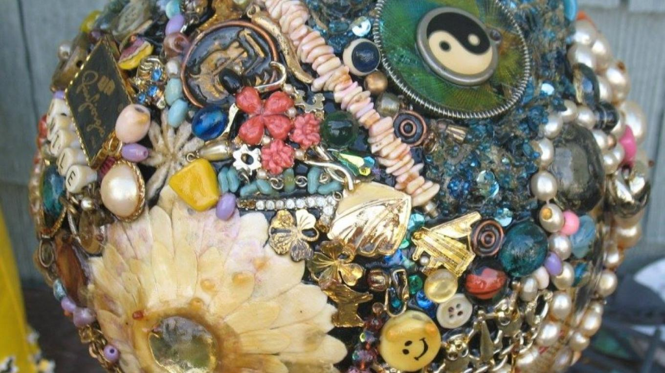 Garden gazing ball crafted from broken costume jewelry and a bowling ball. – Maria Bivins