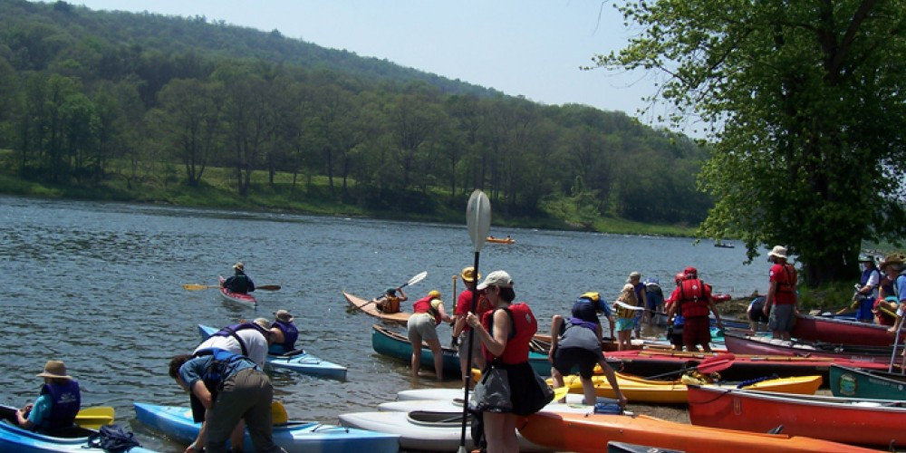 Sojourners prepare to launch and paddle the Upper Delaware Scenic and Recreational River. – Laurie Ramie, Upper Delaware Council