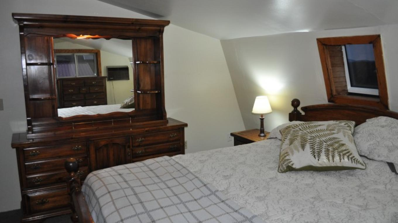 Private queen bedroom in Carriage House efficiency apartment