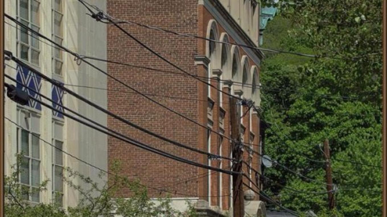 "Art Deco Merchants Bank and Federal Style Bangor Trust Building featuring ""Old Home Week"" heritage mural. – Sharon J. Davis, Slate Belt Community Partnership"