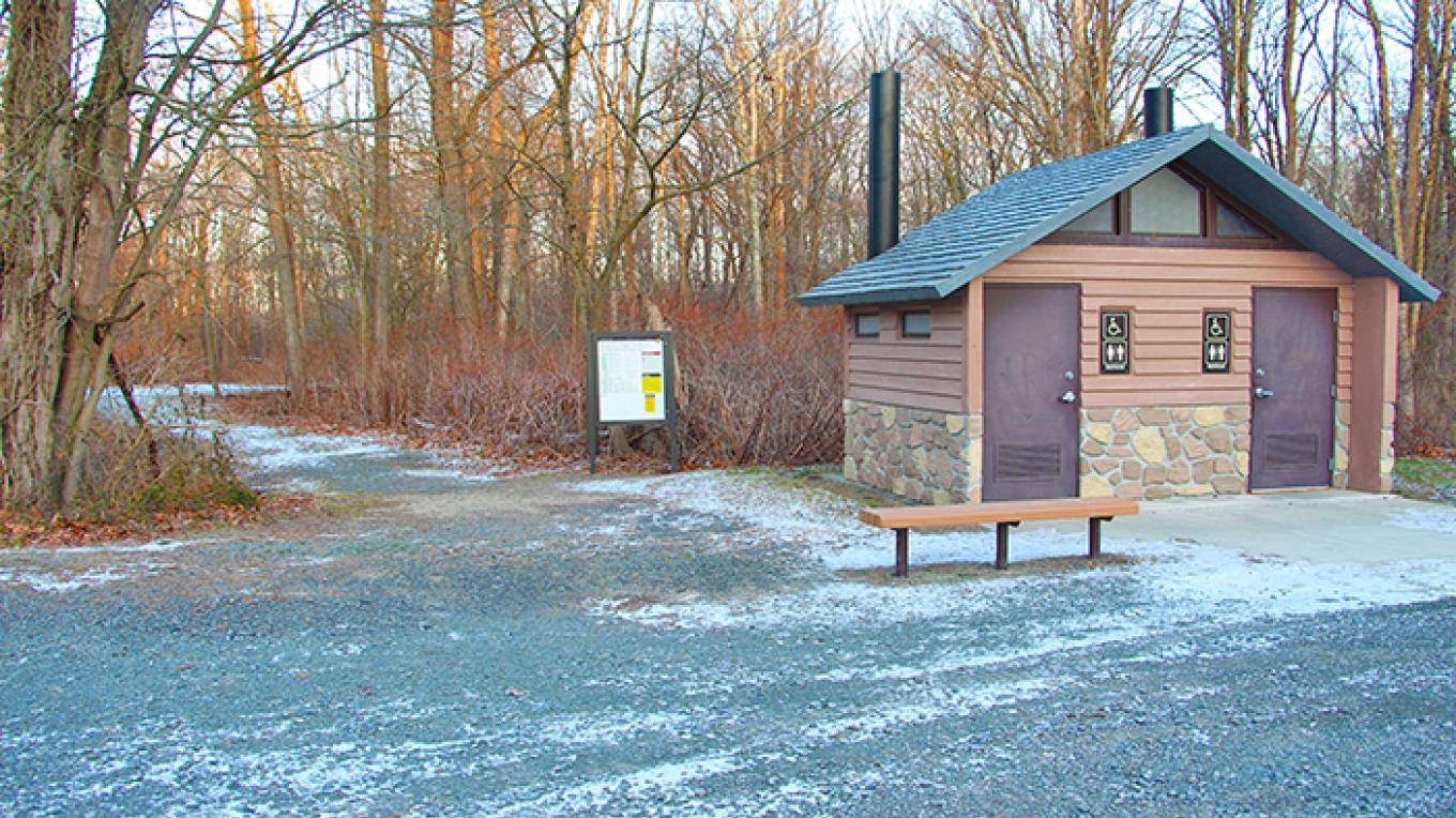 The McDade trailhead north at Bushkill Village is located just beyond the restrooms at Bushkill Meeting Center. – National Park Service
