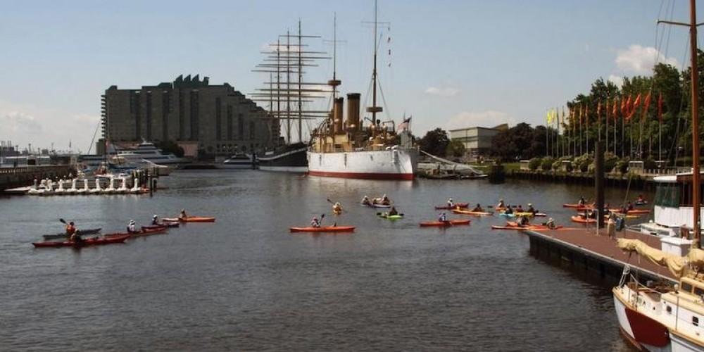 Sojourners paddle in the Penn's Landing Marina, Philadelphia, Pa., on the 2015 Delaware River Sojourn. – Delaware River Sojourn Steering Committee