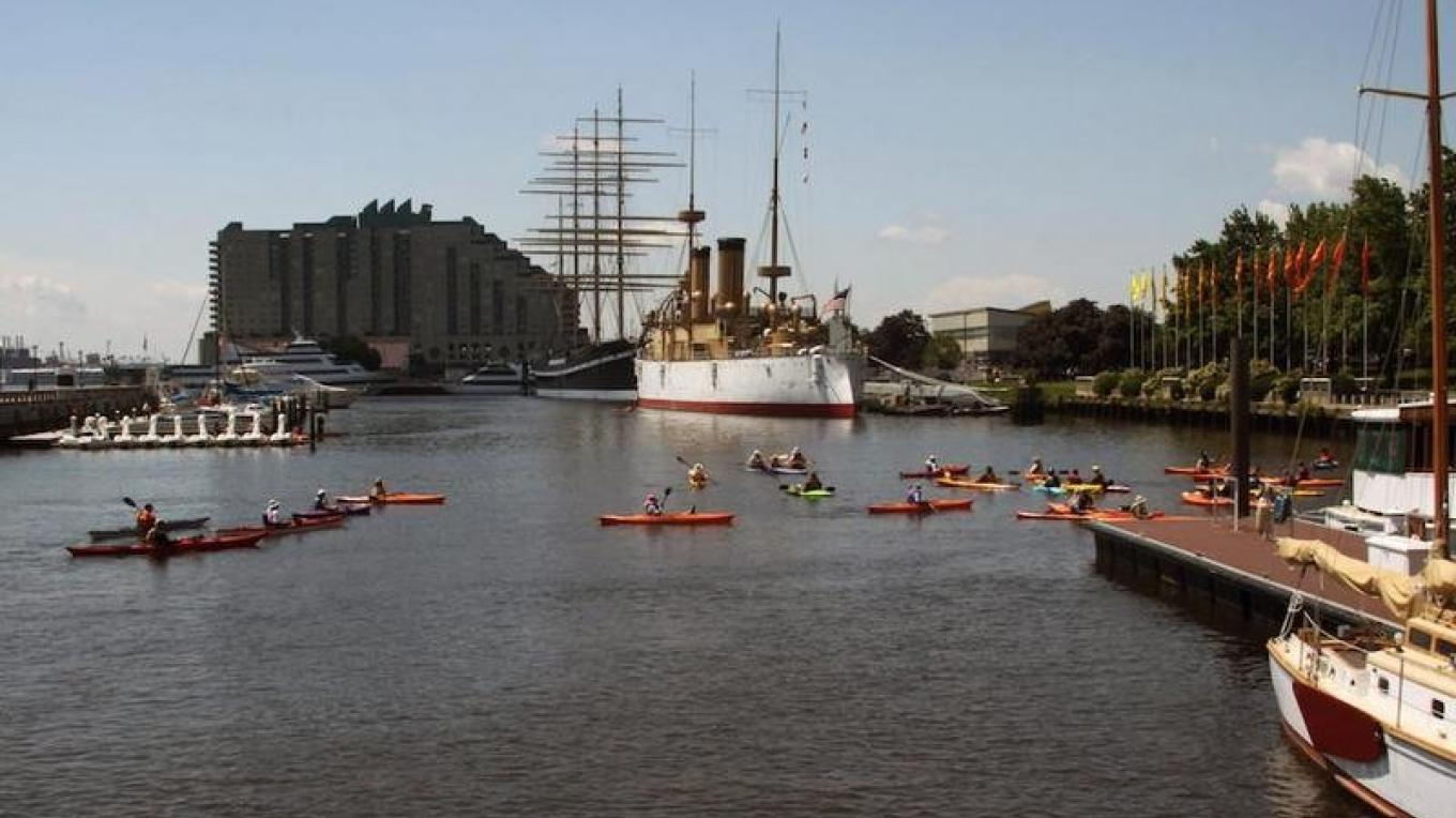 Sojourners paddle in the Penn's Landing Marina, Philadelphia, Pa., on the 2015 Delaware River Sojourn. – Delaware River Sojourn Steering Committee