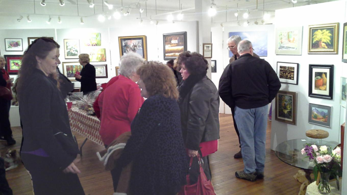 Visitors enjoy one of the artist receptions that occur on the second Saturday of each month. – Rosalind Hodgkins