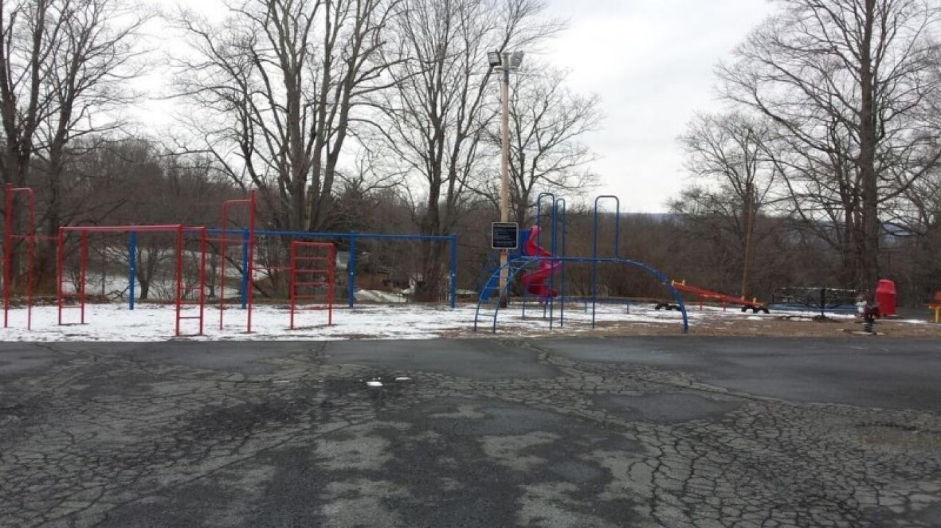 Playground Next to Portland Schoolhouse. Originally built in the 1940s, updated and painted in 2012. – Heather Fischer
