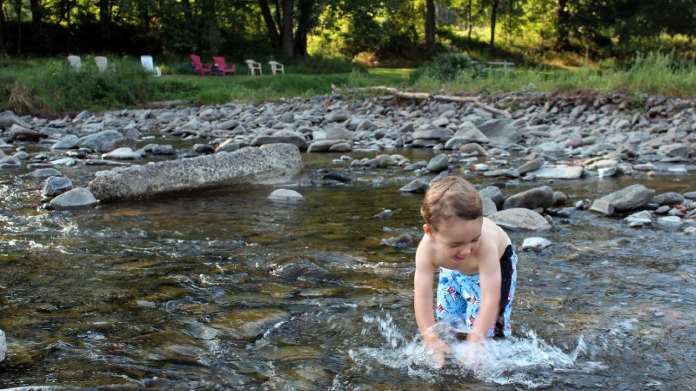 A young boy enjoys the water on the Delaware River – Ali Keech
