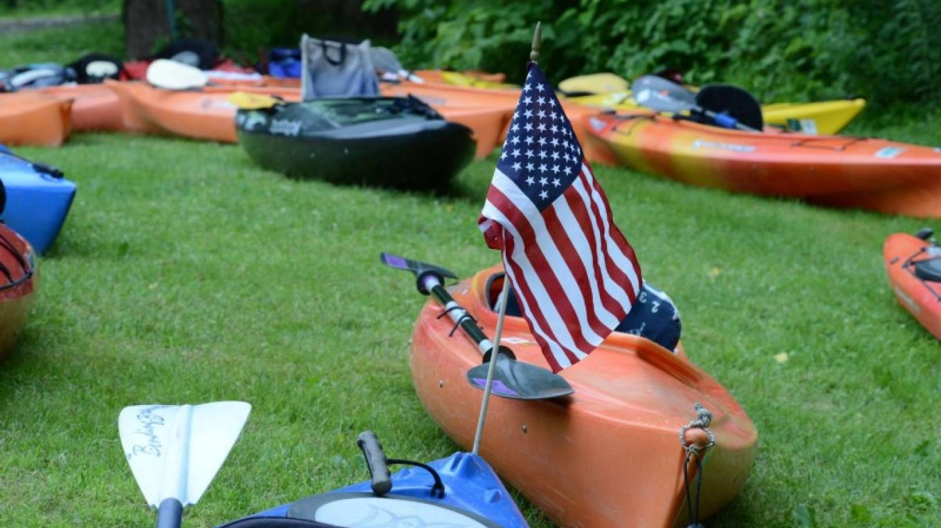 An American flag proudly waves on a sojourner's boat. – Troy Bystrom, Upper Delaware Preservation Coalition