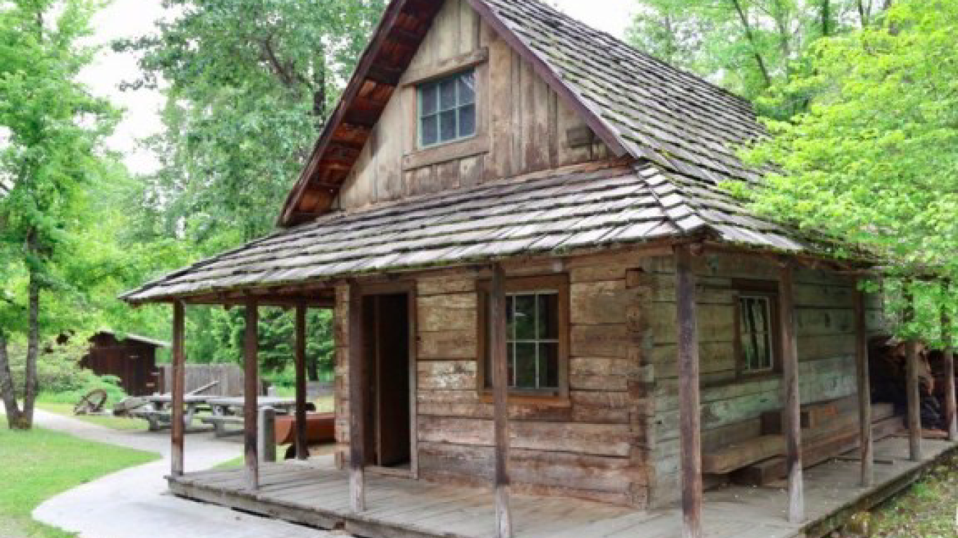 Take a short walk down and around the corner of the Blacksmith shop to find this restored dwelling. It was home to one of many ditch tender cabins from the La Grange mine. Peak inside to see a display of tools used from this time.