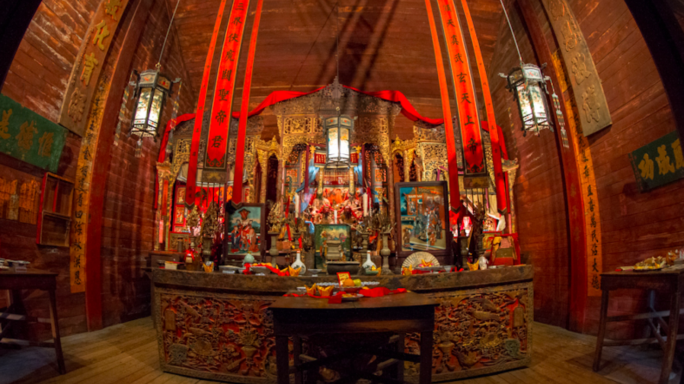 Worshippers visit to pray and to place incense, candles, food, and paper money before the spirit houses and altars.