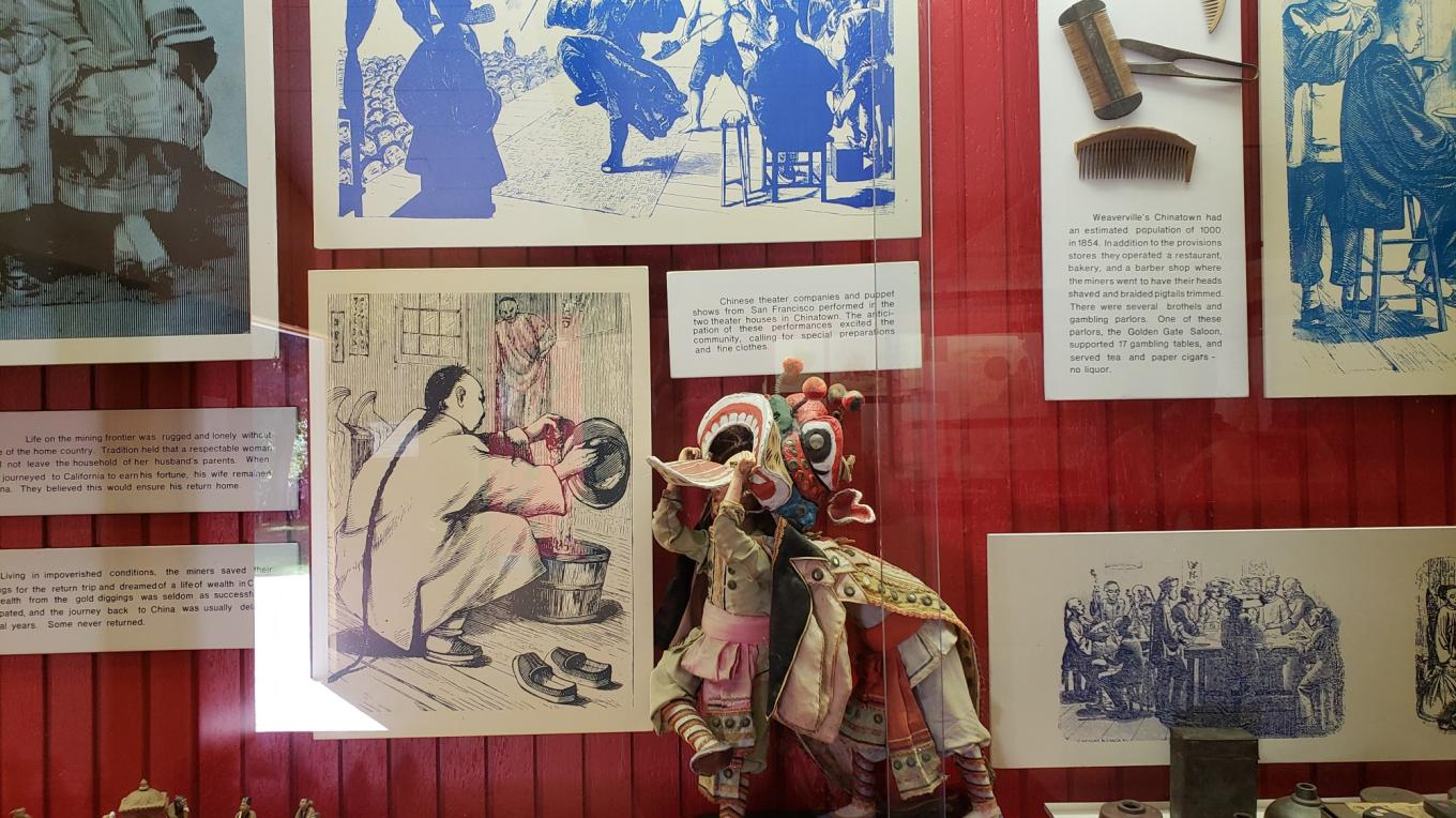 Many displays depicting life of Chinese immigrants in the late 1800's.