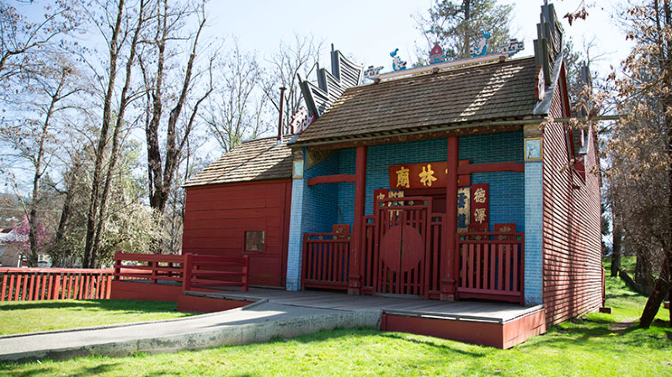 View the front of the temple with bright colors and ornate architecture while standing on the sidewalk of Odds Fellow Ave.