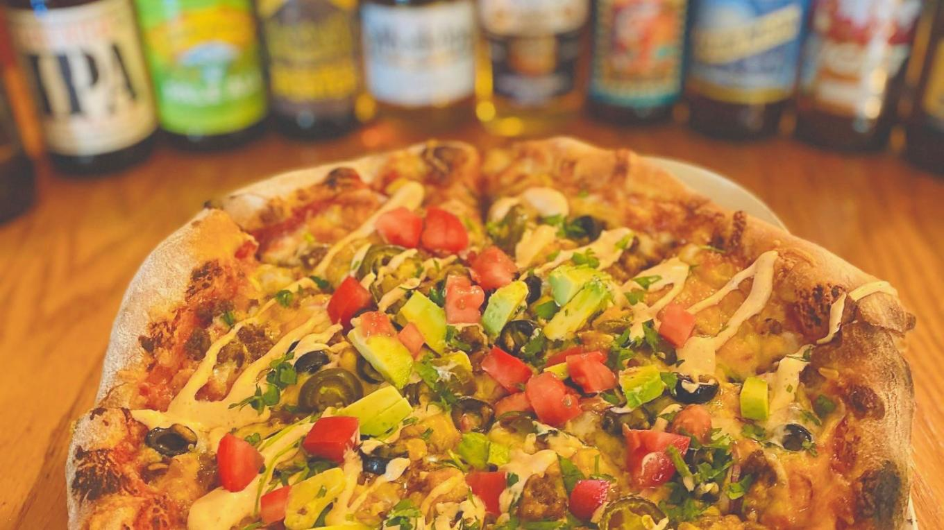 Enjoy a wood-fired pizza after your mountain or lake adventure! Pair it with your beer of choice.